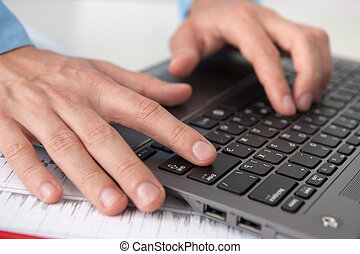 Close-up of  male hands with laptop