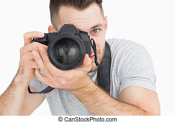 Close-up of male photographer with photographic camera over...