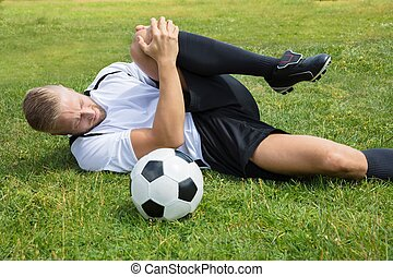 Male Soccer Player Suffering From Knee Injury