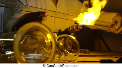 Close-up of male worker creating glass in glass factory 4k...
