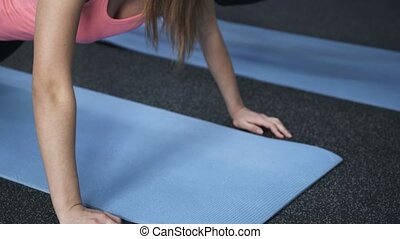 Close up of man and woman doing pushups in a gym