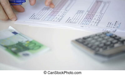 close up of man checking bills