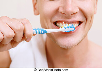 Close up of man cleaning teeth