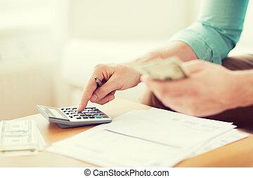 close up of man counting money and making notes - savings,...