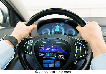 close up of man driving car with gps navigator - transport,...