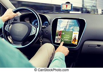 close up of man driving car with news application