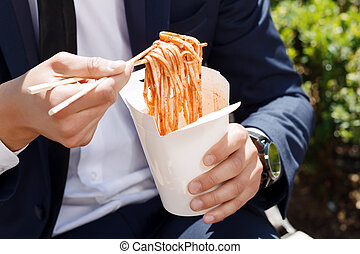 Close-up of man eating Chinese noodles