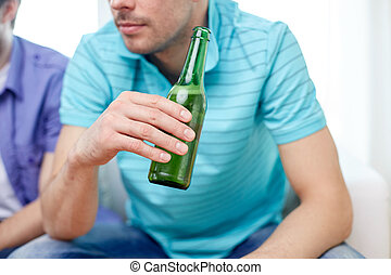 close up of man friends drinking beer at home