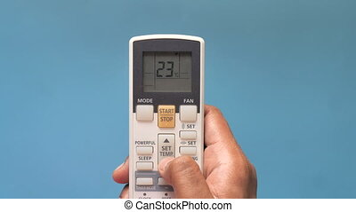 Close up of man hand holding air condition remote
