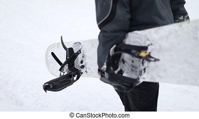 Close Up of Man Hand Holding Snowboard, Walking Up - Close...