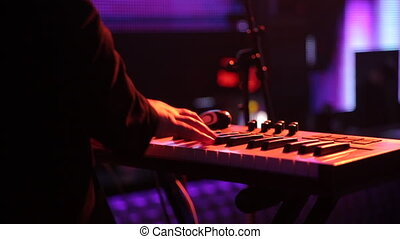 Close up of man hands piano playing on a scene