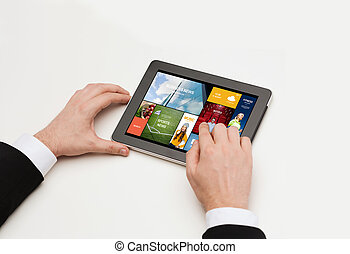 close up of man hands with web pages on tablet pc