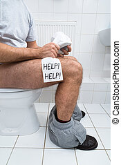 Man In Toilet Holding Tissue Paper Roll With Help Text