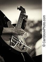 Close up of man playing a guitar