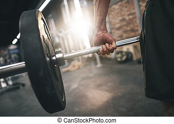Close up of man practicing deadlifts