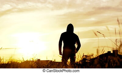 Close up of man running on a camera on sunset background. Slowly