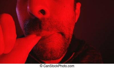 Close up of man sucking his thumb.