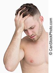 Close-up of man suffering from headache