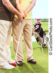 Close up of man teaching to play golf