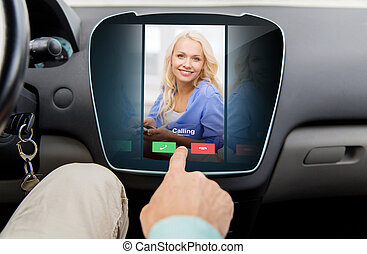 close up of man using phone application in car