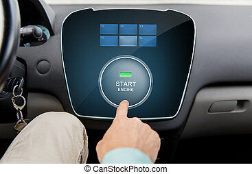 close up of man using starter application in car