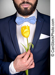 Close up of man with beard and tulip