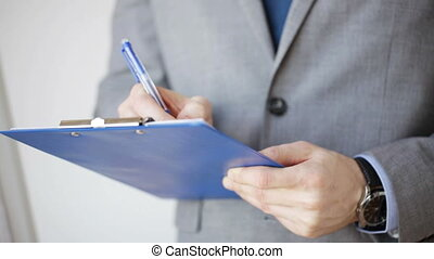 close up of man with business scheme and clipboard -...