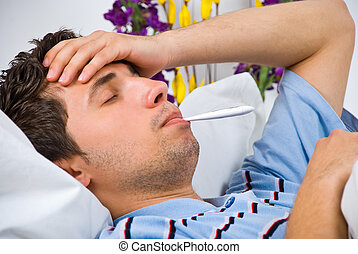 Close up of man with flu - Close up of young man lying down...
