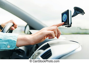 close up of man with gadget on screen driving car -...