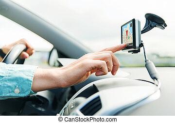 close up of man with gps navigator driving car