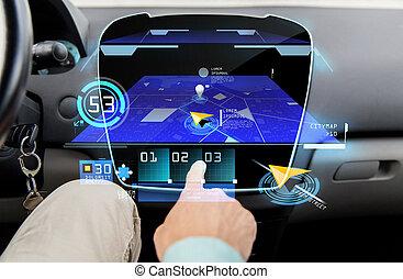 close up of man with gps navigator on car computer -...