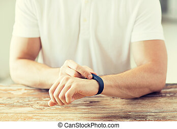 close up of man with heart-rate watch - business, technology...