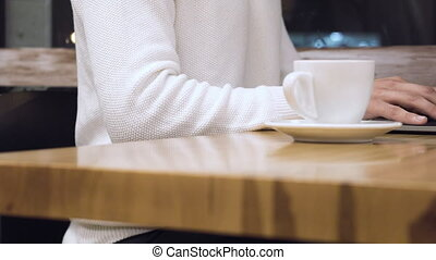 Close Up Of Man With Laptop And Coffee Cup At coffee shop.
