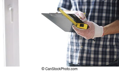 close up of man with measuring ruler and clipboard - repair...