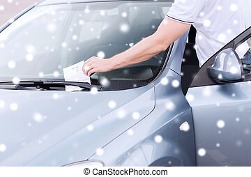 close up of man with parking ticket on car