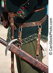 Close up of man with medieval leather sword sheath