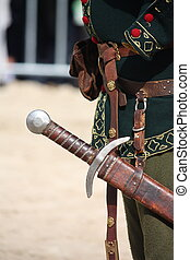 Close up of man with sword sheath