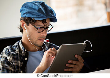 close up of man with tablet pc and earphones
