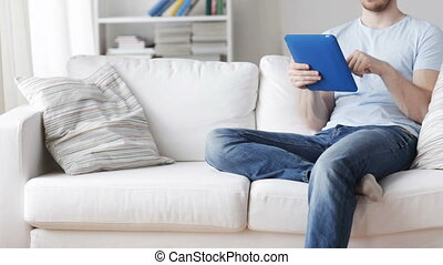 close up of man with tablet pc computer at home