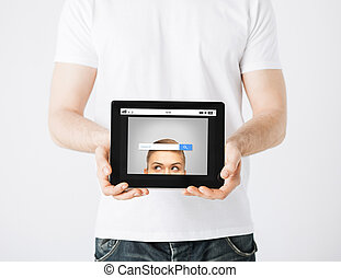 close up of man with web search bar on tablet pc