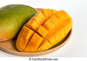 Mango in wooden plate on white background.