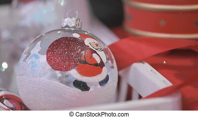 Close-up of man's hand taking Christmas ball