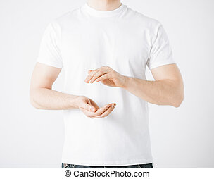 mans hands showing something