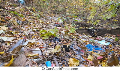 Close up of many garbage lies on the ground in autumn...