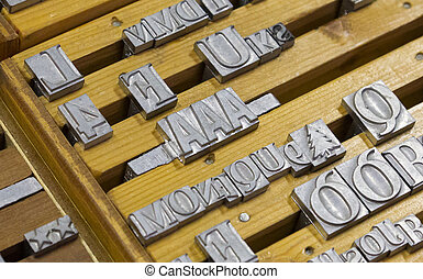 Close up of many old, random metal letters