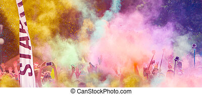 Close-up of marathon runners with colored powder