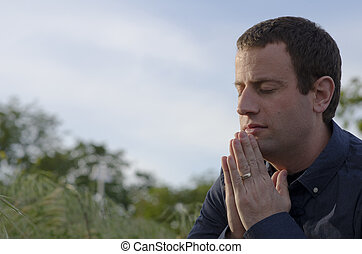 Close up of married man praying. - Close up of married man...