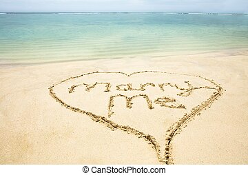 Marry Me Text Inside The Heart On Sand At Beach - Close-up ...