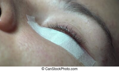Close-up of master lash maker remove oil, preparing for eyelash extension