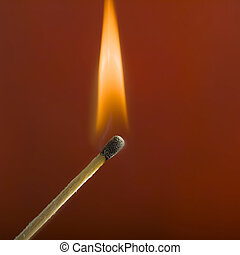 close up of match and flame - studio close up of lite match...